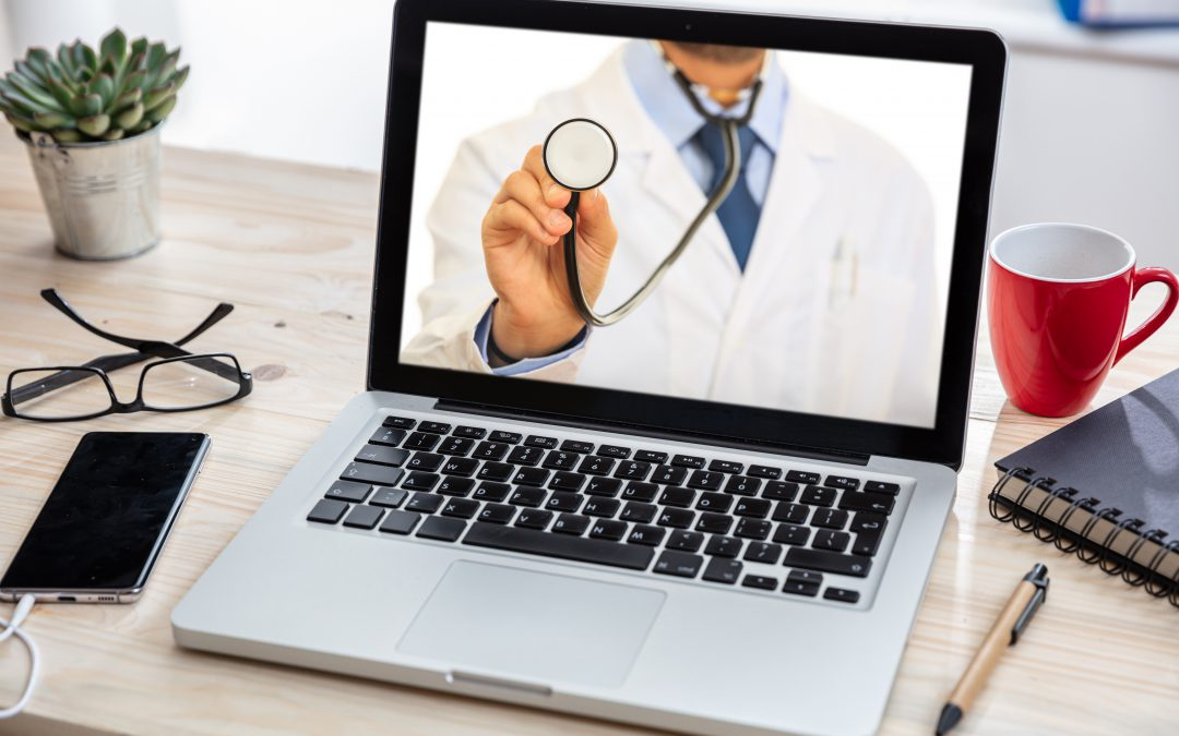 video call with a doctor on laptop